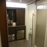 Restroom door, wine bar, cabinet (with plates/cups etc)