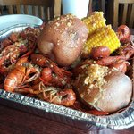fresh crawfish spicy in garlic butter with corn and potatoes