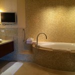 Presidential Suite - bathroom mosaic glass tile walls and jetted soaking tub