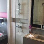 Bathroom looks into bedroom