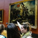 Our charming guide teaches us Delacroix's Liberty Leading the People is about July 1930 Revoluti