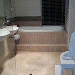 beautiful bathroom with jacuzzi and separate shower. Lots of amenities for your comfort