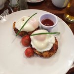 Bacon and leek potato cakes and poached eggs with cherry tomatoes