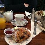 The queens light start; scone (I chose blueberry) butter, raspberry preserve, tea and orange jui