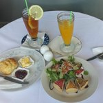 Trio of Quiches, scone, iced tea and fresh juice