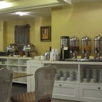 Breakfast buffet: hot dishes, coffee and juice tables on the side of the room