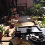 Breakfast in a small balcony and garden.