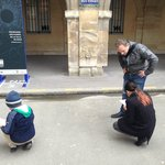 Patrick and my kids solving clues at the start of the tour.
