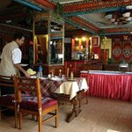 Dining Room with Shambhu in the frame.