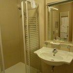 Hotel bathroom - shower, sink & toilet