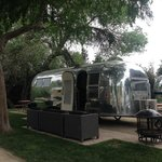 Updated Airstream without outdoor furniture and included fire pit and grill.