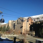 SolNeu with the gondola rising up past the apartments