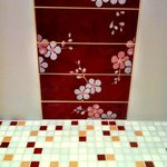 Cherry blosdom theme in the tiles of shower room an floor ( by the colour).