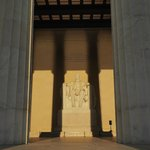 After dawn, lit up by the rising sun. Framed by shadows of the columns