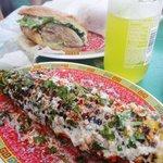 Roast pork sandwich and corn