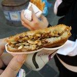 Street food, rice pancake with peanuts, pumpkin nuts filling