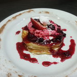 Fluffy Buttermilk pancakes topped with a mixed berry compote and creamy Greek yogurt