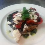 Slow roasted field mushroom,  roast capsicum and goats cheese on toasted sourdough drizzled with
