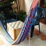 Терраса номера с гамаков и стульями для отдыха