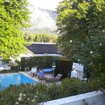 Pool and gardens at French-style Le Franschhoek Hotel