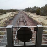 Rail trip to the Canyon.  View from the caboose of the train.  Train station at the village hote
