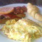 Brakefast: Omelette, croissant, beef sausage, corned beef