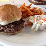 Coastal burger with slaw on the side and sweet potato fries! Yummmm :)