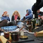 Ecotour, a group of journalist tours in a electric boat through Amsterdam with ecological food
