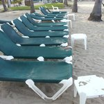 Lounge chairs never cleaned. Dirty with sand and spilled drinks