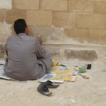 A worker, restoring one block on the base of the Sphinx