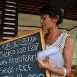 Waitress explain the menu to us