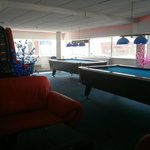 Large comfy sofas and pool tables