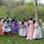 paintballing in bridesmaid dresses