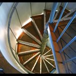 Spiral stairs leading to rooftop bar.