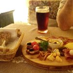 Asorted platter of Lithuanian goodies with beer.