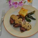 Carne de Cerdo Ibérico a la Brasa con salsa a las cinco bayas