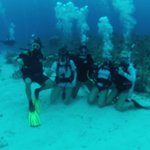 My kids, me and our 2 new certified divers on vacation with us