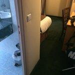 Between room and bathroom