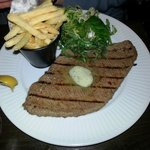 Steak Frites (Chargrilled thinly beaten out Minute Steak served pink with Frites and Garlic Butt