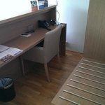 Desk area behind bed