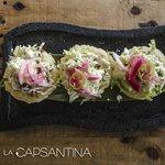 """""""Papadzules"""" Tortillas de maíz, rellenas de cochinita pibil, bañadas en salsa de pipian."""