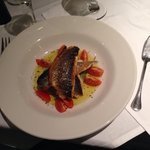 Fillet of sea bass, herb mash, tomatoes and olive oil (on set menu).