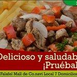 Carne de cerdo, pollo o mixto, salteada con vegetales, ensalada tabbule, papas a la francesa...