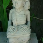 statue beside pool