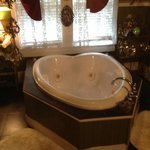 The heart-shaped Jacuzzi for 2 is the centerpiece. They even provide some scnted cubes to add to