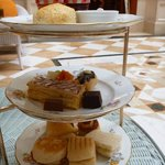 Three tiered plate per person- scones with jam and cream, assorted sweet treats and savouries.