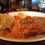 Combo plate: crispy tacos, rice, refried beans, enchilada roja