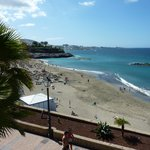 View from the hotel sunbathing area to the beach and Las Americas in the far distance