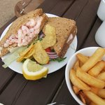 A hugh prawn sandwich with a salad, crisps and bowl of chips. To die for, Bay View Cafe, Bigbury