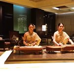 Elegant ladies playing instrument at the hotel lobby.